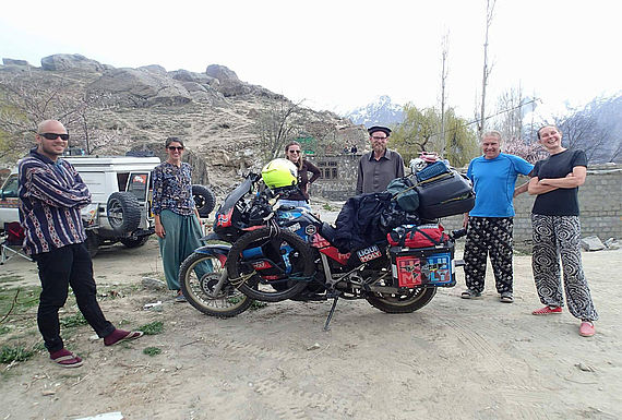 Rahim Resad with new friends in Pakistan before crossing into China
